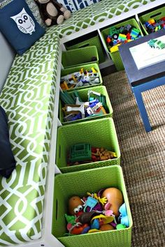 Kids Playroom: Two tall bookshelves on their sides with cushions on top, baskets for toy storage.