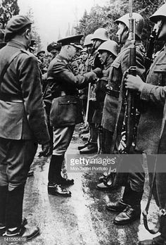 Romanian soldiers who distinguished themselves during the Kerch battle on the Russian front being awarded by Marshal and Prime Minister Ion Victor Antonescu. May 1942 Consigue fotografías de noticias de alta resolución y gran calidad en Getty Images Still Image, Romania, Presentation, Soldiers, Fictional Characters, Digital Prints, High Resolution Picture, Point Of Sale, Montages