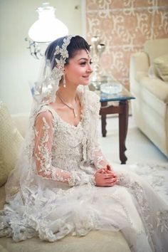 White Georgette with lace veil to embrace the traditional American wedding dress in a South Asian fashion. This look allows you to pull off a traditional South Asian on the day of the wedding without being redundant.