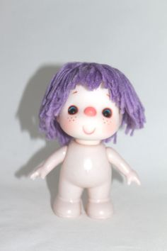Itty Bitty Mitzie 5.5 inch Doll with Purple Yarn Hair for Your Dollmaking Create crocheted or sewn clothing for this cut pink-nosed, blue-eyed doll. This is an especially nice-sized doll for a three-year old. She has freckles on her cheeks, and a winning smile. She comes in blue, pink, and red yarn hair so look at my other listings and buy all four colors by NookCove, $5.73