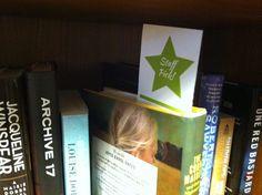 Bookmark, Staff Picks displayed inside of a book