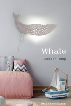 Majestic Blue whale lamp on your wall?This wooden wall lamp looks great both day and night. It will please everyone's eye..In one of 16 colours of our water-based non toxic paints it will fit every interior!Perfect decor for a nautical nursery. #modernlamps  #nurserylamp #prettylamps #lampprojects #lampdecor #nauticalnursery, #nauticaldecor, #walllamp, #pendantlamp, #whalelamp, #bluewhale, #lampdeign, #boholamp