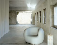 Berlin-based architecture studio Brandlhuber+ Emde, Schneider has transformed an old lingerie factory in Krampnitzsee, Germany, in this combined studio and family home. Arno, Concrete Facade, Concrete Building, Monochrome Interior, Interior Design, Gray Interior, Design Interiors, Living Area, Living Spaces