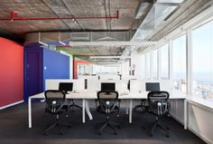 like these desks -- open but still private. Technolabs Open Montevideo Offices