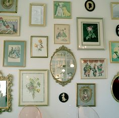 Vintage Wall Decor.   Love all the different portraits and art and mirrors