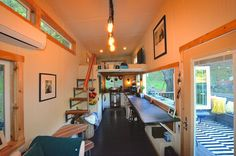 Interesting tiny house about the same size as i hope to make. lots of good solutions such as floor storage in the bedroom loft.