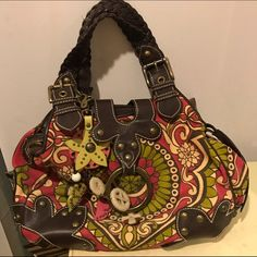 7ce79c23ac64 Shop Women s Isabella Fiore size OS Shoulder Bags at a discounted price at  Poshmark. Description  Canvas patterned and leather handbag.