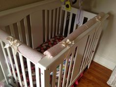 pool noodle, receiving blankets and ribbon to baby proof crib rails. SUPER cheap and effective