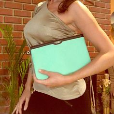 Victoria's Secret Clutch Seafoam/Mint This is a gorgeous BRAND NEW Victoria's Secret clutch (about the size of two hands +) somewhere between a vivid Seafoam/mint colour & robin's egg blue. Has a hole where you can easily add a clip &/or handle. Feel like a Mermaid Goddess and make a statement going out with this beautiful piece! Victoria's Secret Bags Clutches & Wristlets