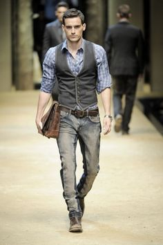 male fashion is always fun to mix and match styles with distressed leather, vintage jeans and a classic yet modern vest.