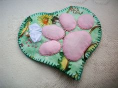 Handmade heart brooch with cat paw print motif outlined in stem stitch, ribbon flowers and french knots. The brooch is lightly padded and has a silver coloured safety clasp. Free gift wrapping s. Cat Paw Print, Gift Wrapping Services, French Knots, Cat Paws, Ribbon, Brooch, Stitch, Cats, Heart