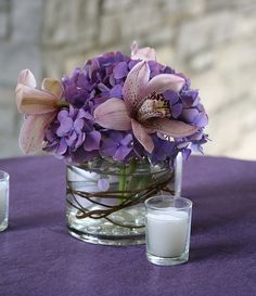 Small cylinder w/purple hydrangea, pink orchid, and grapevine accent