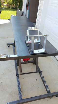 Hydraulic motorcycle lift table. 8t pneumatic assisted hydraulic Jack ram. Bike-Pro Wheel chock. Also my welding table. Rocket Science Customs RSC.
