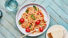Think of this weeknight-friendly pasta recipe as a lighter take on the classic Italian ragù that features cherry tomatoes, a red chile for some heat, and tons of fresh basil. It will also take you under an hour to make!