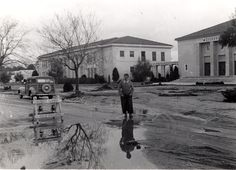 "Canoga Park High School after a rainstorm, 1950. Back of photograph reads, ""That whole front yard is mud. The teachers got out at noon and scraped the sidewalks.""  Canoga-Owensmouth Historical Society. San Fernando Valley History Digital Library."