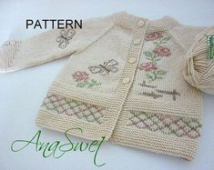 Hand knitted baby cardigan wit