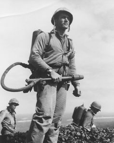 operationbarbarossa:    Corporal Charles W. Lindberg, a US Marine, with a flame thrower on Iwo Jima - 1945  Lindberg helped raise the first American flag above Mount Suribachi on 23 February 1945 and was awarded the Silver Star Medal for his actions as a flame thrower operator on Iwo.
