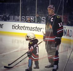Tazer with 4 year old Make a Wish kiddo at Stadium series practice.