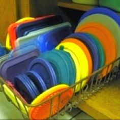 Use an old dishwasher rack to organize your Tupperware and more
