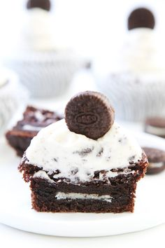 Cookies and Cream Cupcakes Recipe on twopeasandtheirpod.com Chocolate cupcakes with cookies and cream frosting and an Oreo surprise inside! They are perfect for birthdays or any celebration!