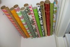 Store wrapping paper on your closet ceiling.-- What better place to store those rolls of gift wrap than how this post suggests.