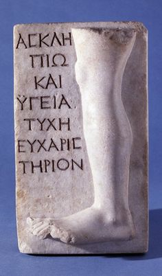 Marble relief representing part of a leg with an inscription dedicating it from Tyche to Asclepius and Hygieia as a thank offering, presumably for the cure of some affliction of the left leg. 100-200. (Most of the anatomical votives in the British Museum's collection aren't of legs, if you catch my drift.)