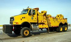 This wrecker is hidden away at Chicago's O'Hare International Airport. Dump Trucks, Cool Trucks, Big Trucks, Heavy Duty Trucks, Heavy Truck, Sterling Trucks, Car Hauler Trailer, 6x6 Truck, Towing And Recovery