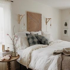 A bedroom we'd want to spend all weekend relaxing in. Photo by Shaynah #homestoryinteriors