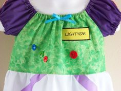 buzz lightyear dress!  This has a lot of really cute Disney dresses--all based of an easy peasant dress.