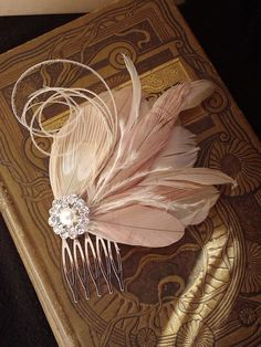 Beautiful blush feather fascinator bridal hair comb, with Crystal and pearl accent
