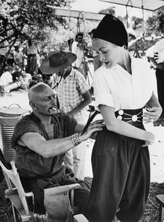 Yul Brynner Helping Janet Leigh with Outfit  Janet Leigh tries on a gaucho outfit, with Yul Brynner's assistance, in Salta, Argentina. Brynner, along with Leigh's husband Tony Curtis, was in Argentina making Taras Bulba, a movie about Cossacks.