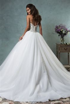 #Wedding Dresses & Bridal Gowns ♥ 2016 Enchanting Beaded Lace & Tulle Ball Gown with a Strapless Sweetheart Neckline, Crystal Beaded Lace Fitted & Boned Bodice with Lightly Padded Bust Cups, Gathered Tulle Ball Gown Skirt, Chapel Train, Embellished Back with Covered Buttons to Hem. #fairytaleweddingdress #beadedweddingdress #crystals #straplessweddingdress #laceweddingdress #ballgown #tulle #beautifulbride #bridalgown #2016weddingdress #sayyestothedress #dreamwedding #gorgeous #princess…
