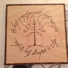 Pyrography of Tree of Gondor surrounded by Elvish by Theburnttree