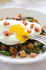 Spring breakfast hash - sauteed asparagus, diced Yukon gold potatoes, pancetta and shallots then topped with an egg.