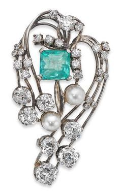 An emerald and diamond brooch Of stylised foliate design, set with an octagonal-cut emerald within a trailing openwork frame, set throughout with old round brilliant-cut diamonds and cultured pearls, length 45mm, stamped 'C&F' and '18ct', the emerald estimated to weigh approximately 2.15cts, the diamonds estimated to weigh approximately 4.29cts in total