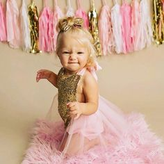 Sassy babe @henley_grace feels fabulous in @bellethreads  Our Classic pink, blush and peach Sparkle Rompers are made with an all sequin bodice and tutu around.  These outfits always glam up your babe's special day!