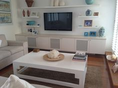 like the shelving around TV and wall hung unit More