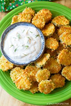 """Amazing Oven Baked """"Fried"""" Pickles with Garlic Sauce. Get your southern fried pickle fix without all the calories! My first experience with fried pickles w"""
