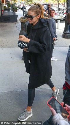 Inseparable: Gigi Hadid, right, and her beau Joe Jonas, left, were spotted out in New York...