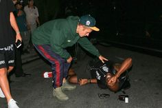 Justin, 23, got out of his car and went to help the pap, who was seen lying on the ground.