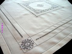 Tablecloth. Linen tablecloth. Embroidered tablecloth. White tablecloth. White embroidery.