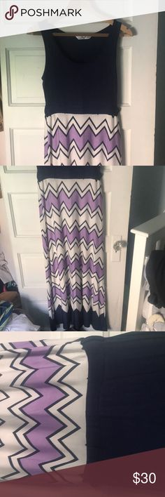 "Beautiful maxi dress from Christine V. The top is a navy blue tank style that is super soft. The waist has a little cinching and two hoops for a belt that can either be cut off or worn with a cute belt. This dress is new and never been worn. The bottom is a purple, white and navy chevron with about 6 inches of solid navy at the bottom. it is a true maxi dress and falls to the top of my feet and I am 5'10"" Two pics of models shows the dress in different colors and a slightly different top! My…"