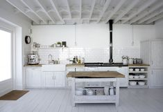 """""""The Delicious Miss Dahl""""'s home: white heaven London home that belongs to Paul Massey 