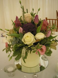 Vintage style bucket/pail arrangement using, Roses, Trachelium, Tulips and Veronica.