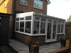 White PVCu DIY Lean-to Conservatory, Dwarf-Wall Model. Sunlounge Conservatories Manufactured and supplied by ConservatoryLand DIY Conservatories. Orangery Conservatory, Lean To Conservatory, Conservatory Design, Conservatories Uk, Cottage Extension, Flat Roof, Décor Ideas, Sunroom, Tiny House