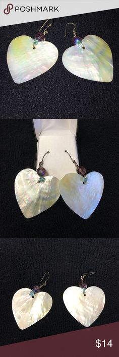 "Beautiful shell heart shape dangle earrings 2&1/2"" Beautiful shell heart shape dangle earrings. 2&1/2"" long x 1&1/2"" wide.                     ************                    ✔️BOGO✔️            💍JEWELRY SALE!!!💍  Buy one get one of equal or lesser value for free.  Just add 2 or more items to bundle then make offer for amount of one item. BUY ONE GET ONE FREE Jewelry Earrings"
