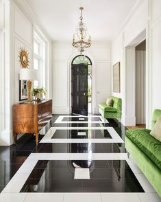 Simply grand . . . Accents of green with the black granite and white marble floor make a statement in this chic entry foyer. #interiordesign #petervitale #ruardveltmanarchitecture #milieumag