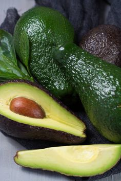 green ripe avocado with leaves