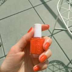 ITG's editors dub Essie's orange-y red Clambake the official nail color of the season.