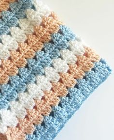 This is a free pattern for a crochet modern granny blanket. As I made this crochet modern granny blanket, I felt like I was creating a series of triangles nestled in between each other which to me, gave the blanket a modern feel. Crochet Afghans, Crochet Stitches Patterns, Baby Blanket Crochet, Crochet Yarn, Free Crochet, Knitting Patterns, Easy Crochet Blanket Patterns, Granny Stripe Blanket, Crochet Simple
